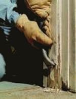 Dry scraping lead paint