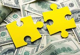Puzzle pieces on money-WR.jpg